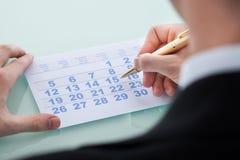 Hand Marking Date 15 On Calendar Royalty Free Stock Photos