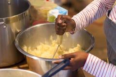 Hand mashing potato stock photography