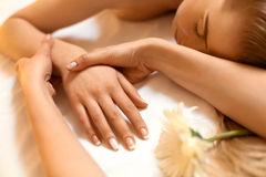 Hand Massage. Beautiful Blonde Gets Spa Treatment in Salon. Stock Image