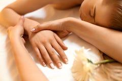Hand Massage. Beautiful Blonde Gets Spa Treatment in Salon. Stock Image