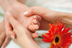 Hand Massage. Beautiful Blonde Gets Spa Treatment in Salon. Stock Images