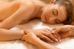 Hand Massage. Beautiful Blonde Gets Spa Treatment in Salon. Stock Photography