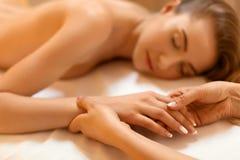 Hand Massage. Beautiful Blonde Gets Spa Treatment in Salon. Hand Massage. Beautiful Blonde Gets Spa Treatment in Salon Stock Photography