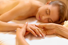 Hand Massage. Beautiful Blonde Gets Spa Treatment in Salon. Royalty Free Stock Photography