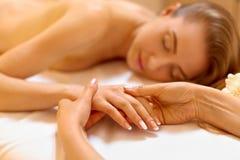 Hand Massage. Beautiful Blonde Gets Spa Treatment in Salon. Hand Massage. Beautiful Blonde Gets Spa Treatment in Salon Royalty Free Stock Photography