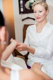 Hand massage by a blonde therapist royalty free stock photography