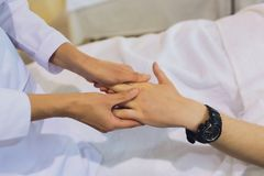 Hand massage. Physiotherapist pressing specific spots on female palm. Professional health and wellness acupressure. Manipulations, copy space, closeup royalty free stock photography