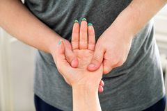 Stroking massage of hands close up. Hand massage. Stroking massage of hands close up. Detail take of a massage session on a hand. Hand massage in the day spa Royalty Free Stock Photos