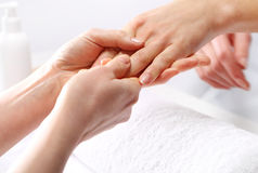 Hand massage, a woman in the beauty salon Royalty Free Stock Photos