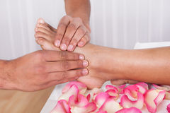 Hand Massaging Foot In Spa. Close-up Of Hand Massaging Foot In Spa Stock Photography