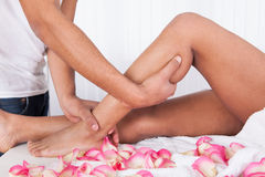 Hand Massaging Leg In Spa Royalty Free Stock Images