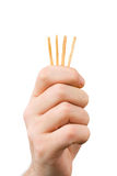 Hand and matches - draw lots Royalty Free Stock Images