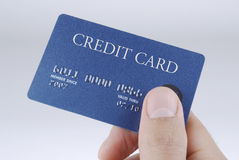 Hand me the Card. Handing over the credit card Royalty Free Stock Images
