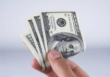 Hand me the Money. Handing over a stack of 100 bills Stock Photos