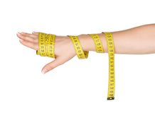Hand with measure tape Stock Photography