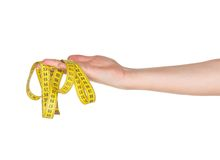 Hand with measure tape Stock Image