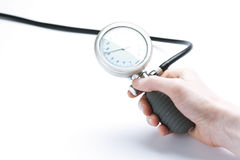A hand measuring blood pressure Royalty Free Stock Photography