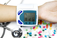 Hand measuring blood pressure with Tonometer Stock Image