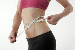 Hand measuring waist Stock Image