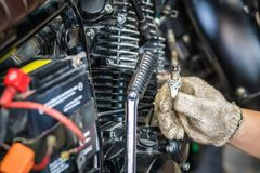 Hand of Mechanic Check and a spark plugs . maintenance selecti. Ve focus Stock Photo