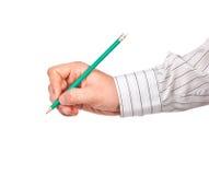 Hand med blyertspennan Arkivfoto