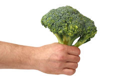 Hand med broccoli på vit royaltyfria foton