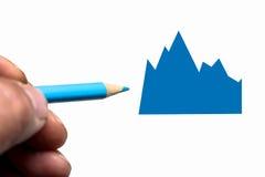 Hand med den blåttblyertspennan och grafen Royaltyfri Bild