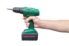 Hand med den elektriska drillborren Arkivfoto