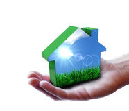 Hand med den gröna Eco husnaturen Arkivfoto