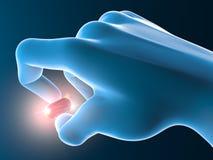 Hand med den röda preventivpilleren, minnestavla Arkivfoto