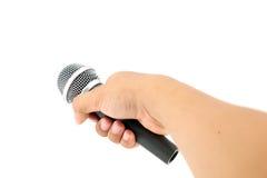 Hand med en mikrofon Royaltyfria Bilder