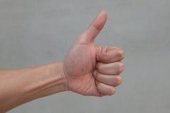 Hand med en signe Arkivbilder