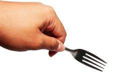 Hand med gaffeln i rätt riktning som isoleras på w Royaltyfria Bilder
