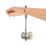 Hand med handbojor och pengar Royaltyfri Foto