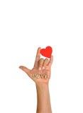 Hand med hjärta och bokstaven Arkivbilder