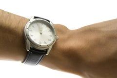 Hand med klockan Arkivbild