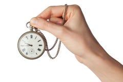 Hand med klockan som isoleras på vit bakgrund Royaltyfri Fotografi