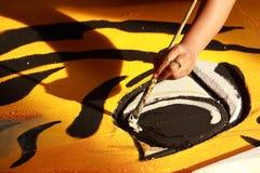 Hand med målningborsten Fotografering för Bildbyråer