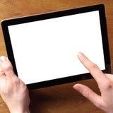 Hand med minnestavlan som trycker på den tomma vita skärmen Royaltyfri Foto