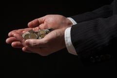 Hand med mynt royaltyfria foton