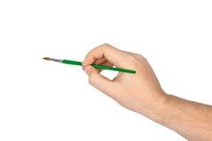 Hand med paintbrushen Royaltyfri Foto