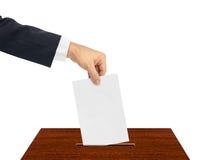 Hand med pappers- sluten omröstning royaltyfri foto