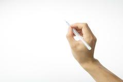 Hand med pennan Arkivbilder