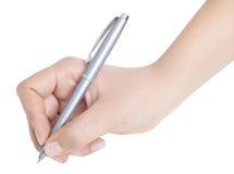 Hand med pennan Arkivfoto