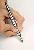 Hand med pennan Fotografering för Bildbyråer