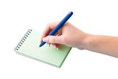 Hand med pennwriting på anteckningsboken Arkivbild