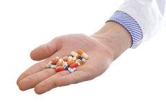 Hand med pills Fotografering för Bildbyråer