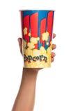 Hand med popcorn Arkivbilder