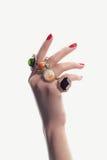 Hand med smycken och manikyr Arkivfoto