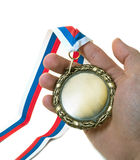 Hand and medal Stock Images
